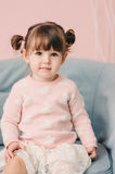 Vertical close up indoor portrait of cute happy baby girl Royalty Free Stock Image