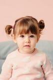 Vertical close up indoor portrait of cute happy baby girl Stock Photos