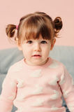 Vertical close up indoor portrait of cute happy baby girl Royalty Free Stock Images