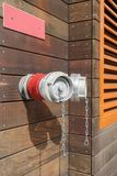 Red fire hydrant on wall of building royalty free stock photo