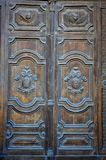 Wooden door of St. Publius Parish Church in Floriana, Malta. Vertical close-up photo of St. Publius Parish Church- wooden ornamental door in Floriana, Malta Stock Images