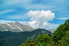 Vertical clouds over mountains Royalty Free Stock Photo
