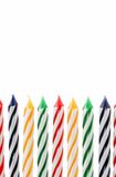 Vertical Colorful Candles Against White Background Stock Images