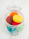 Vertical colorful cookies in crystal flask Stock Images