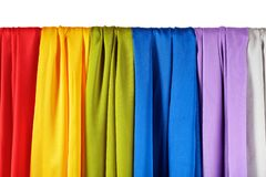 Vertical colorful satin curtains isolated on white. Background stock images