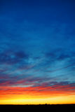 Vertical colorful sunset over land Royalty Free Stock Image