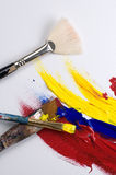 Vertical Composition of Acrylic Paint and Brushes Royalty Free Stock Photos