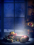 Vertical composition Christmas night with bluish hue dream front. Christmas composition on Christmas Eve. Glow gift, tree and decoration balls with window Stock Photo