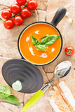 Vertical composition of Tomato soup in a black casserole Royalty Free Stock Photography