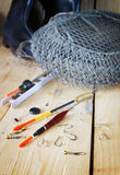Vertical composition with various fishing floats and angling cage Stock Photo