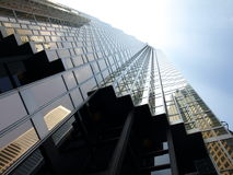 Vertical Corporate Windows. Looking up towards Corporate Windows on a clear day stock image