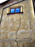 The  vertical crack on the wall. Across window Stock Photo