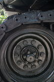 Vertical CU detail of roller and partial tread on captured US Army tank on display in Vietnam Variation  1 Royalty Free Stock Photography