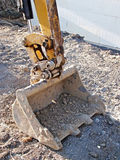 Vertical da cubeta do escavador fotografia de stock