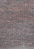 Vertical dark red brick wall background, wallpaper. Red bricks pattern, texture.. Vignette background. Vertical dark red brick wall background, wallpaper. Red stock photography