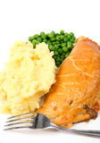Vertical de la comida de las patatas y de los guisantes de la empanada imagenes de archivo