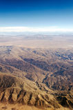Vertical Desert View. View of a dry desert from an airplane somewhere over South America royalty free stock photo