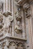 Vertical detail of upper section of the Duomo di Milano populated with statuary. The Duomo di Milano has more statues attached to the building than any other in Royalty Free Stock Image