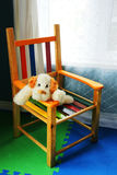 Vertical of dog in kid chair. Royalty Free Stock Photography