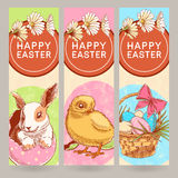 Vertical Easter greeting banner. Three beautiful Easter greeting banner with cute chicken and rabbit and basket with eggs Stock Photography