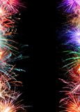 Vertical Fireworks Border. Fireworks vertical border with space for copy on black background Royalty Free Stock Image