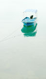 Vertical fishing boat Stock Images