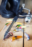 Vertical fishing composition with various artificial baits and spinning Stock Photos