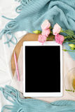 Vertical Flat lay tablet and flowers on white blanket with turquoise plaid. Window light, space for text blog, posts Stock Images