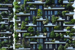 Vertical forest. Contemporary architecture in Milan, Italy. New urban development in Milan, Italy. The vertical forest: trees and plants growing on balconies of Royalty Free Stock Image