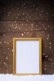 Vertical Frame With Copy Space On Snow And Snowflakes Royalty Free Stock Photo