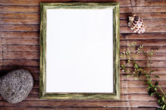 Vertical frame with white blank page vintage photo background. Rustic wooden board with natural decor. Retro style flat lay with hipster camera bag. Shabby Stock Images