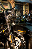 Vertical Front View of Fat Cruiser Motorcycle with Chrome Fork a. Front of Fat Cruiser Motorcycle with Chrome Fork at Night; double headlight and front brake Stock Image