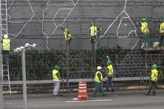 Vertical garden. Sao Paulo, SP, Brazil, April 08, 2017. Workers are installing the vertical garden on 23 de Maio Avenue, south of Sao Paulo. The plants replace Royalty Free Stock Photography
