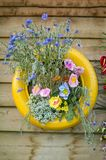 Vertical Garden With Yellow Painted Tyre Royalty Free Stock Photo