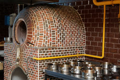 Vertical gas heated tandoor oven in restaurant kitchen Stock Photos