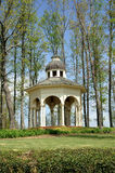 Vertical Gazebo. Horizontal view of garden gazebo surrounded with early new spring growth royalty free stock photography
