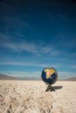Vertical Globe in Desert Waste Royalty Free Stock Images