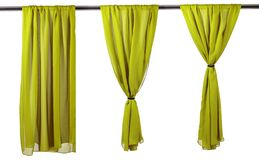Vertical green satin curtains isolated on white. Vertica lgreen satin curtains isolated on white background royalty free stock image