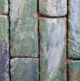 Vertical greenish brick wall for texture and background Stock Photos