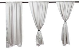 Vertical grey satin curtains isolated on white. Background royalty free stock image