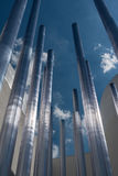 Vertical Group of Steel Metallic Pipe and Blue Sky in Background Stock Photos