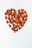 Vertical Heart shaped Candy Corn on a white background. Candy corn shaped into a heart for an autumn decoration stock photography