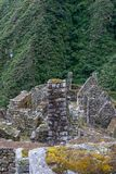 Vertical image of ancient Inca town and the green Andes. Ancient stone ruins of an Inca town on the Inca Trail in the Andes mountains. Cusco. Peru. South stock photography