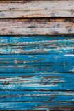 Vertical Image Of Antique Wooden Boards With Scraped Blue Paint. Vertical image of weathered wooden planks with chipped and scraped blue paint stock photo