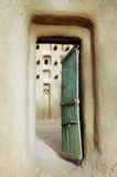 Vertical image of a door into a Dogon mud mosque Royalty Free Stock Photography