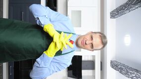 A vertical image. handsome man in tie and apron wearing rubber gloves stock footage
