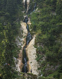 Vertical image of the high waterfall Stock Photography