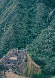 Vertical image of Inca town in the Andes. Ancient stone ruins of an Inca town on the Inca Trail in the Andes mountains. Cusco. Peru. South America. No people stock image