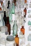 Vertical image of old bottles at flea market, Washington County Fair, New York, 2016 Royalty Free Stock Photos