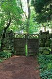 Secluded place in the woods, with beautiful gate and stone wall, Yaddo Garden, Saratoga, 2017 royalty free stock images